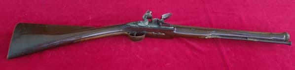 A rare Napoleonic era Flintlock brass barrelled Coaching Blunderbuss by Moore of London.  Ref 2798